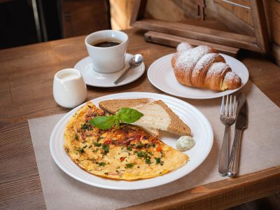 breakfast. Omelet with greens, croissant and coffee